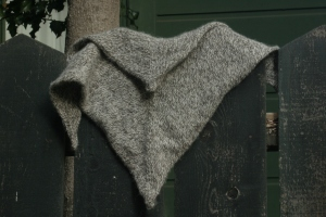 """A toasty warm """"kerchief"""", knit in stockinette, and increased in the center."""