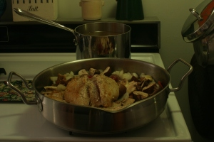 A pot of simmering chicken stock hides behind a skillet of chicken to be braised.  That's a happy sight to see, innit?