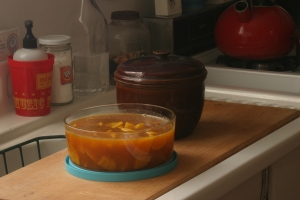 Roasted beets in chicken stock, and the earthenware pot in which I baked 'em.