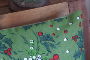 One of a pair of zippered throw pillow covers that I made this year.  The holly fabric was an Oakland White Elephant Sale (OWES) score a few years ago - it looks and feels like it's from the late 50s or early 60s, but as there's no info on the selvage edge its true age is a mystery.  The back is made of some soft green flannel that I suspect I purchased at OWES last year (I really ought to keep track of such things).  The only brand-new components were the zippers.  Off all the things I made this winter, these pillow cases were the easiest (up to and including installing the zippers).